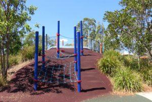 Climbing nets going up a hill in a park
