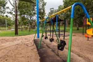 line of swings in doug larsen park.