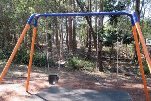double swing set in a park