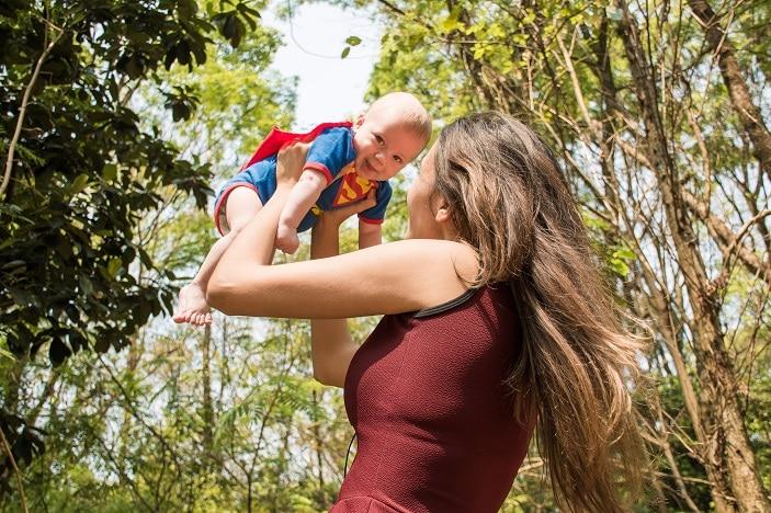 a brisbane mum holding her baby