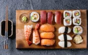 Board with different sushi on it