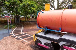 pretend train and train track in playground.