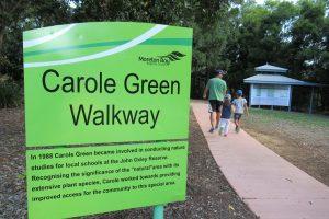 Green sign showing carole green walkway