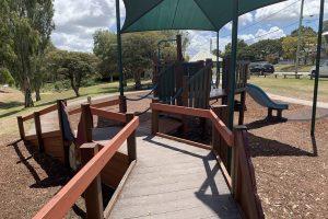 wooden ramp in an outdoor playground.