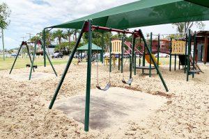 green outdoor swing sets in thorneside park.