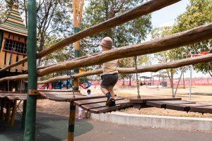 Child crossing draw bridge in Underwood Park