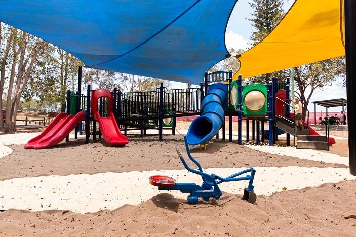 colourful underwood playground under shade sails
