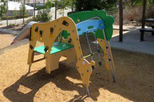 Giraffe-shaped climbing frame in a park
