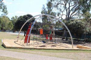 climbing net in sand based playground.