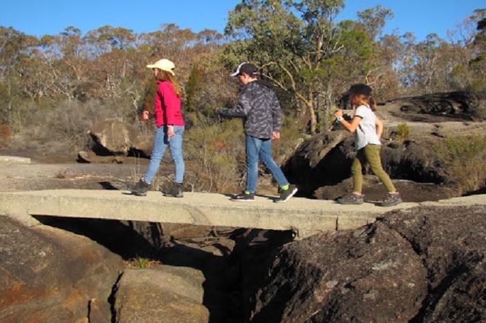 three children bush walking at Girraween National Park