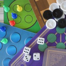 A selection of board games, with playing pieces and dice