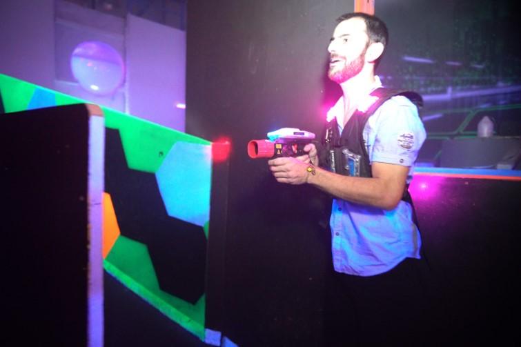 Man playing lasertag in the dark