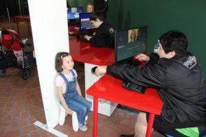 Toddler getting photo taken at kids driving school at Movie World