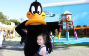 Smiling toddler with Daffy Duck at Movie World