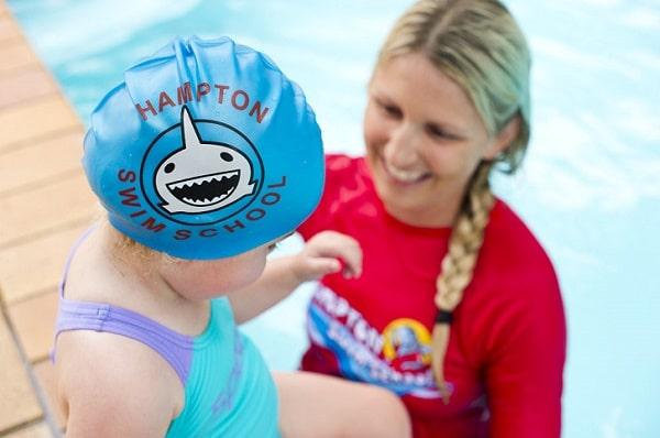 children learning to swim