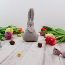 Easter scene with a felt rabbit, flowers and chocolates