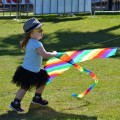 girls with rainbow kite, festival grounds