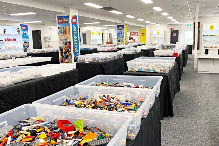 Big containers of secondhand Lego laid out on tables in Brick Resales showroom