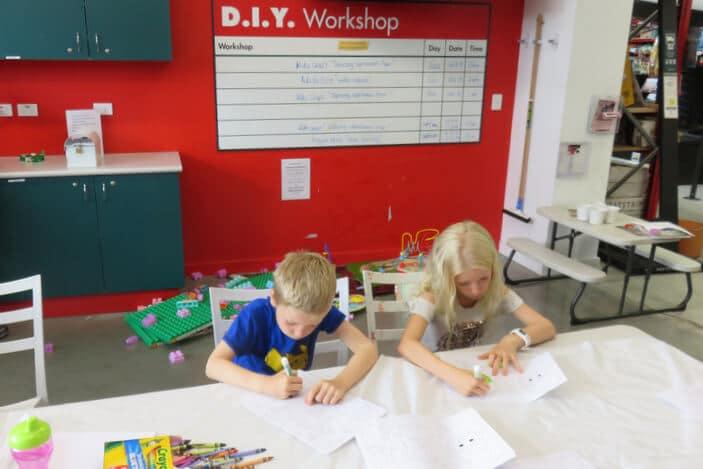 Boy and Girl doing crafts at DIY Workshop