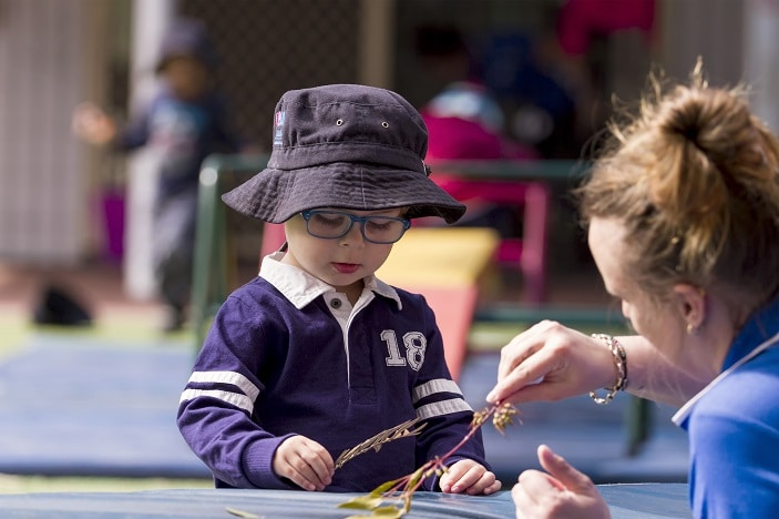 AEIOU child with autism being supported in early education