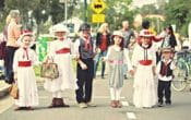 Kids dressed up as chacaters from mary Poppins, chimnet sweep, Mar Poppins, street festival, day in the park