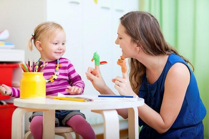 child sitting with speech therapist