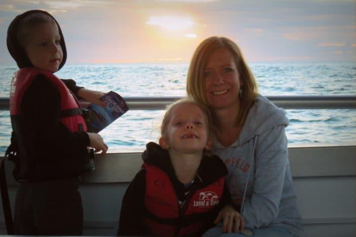 Family enjoying sunset on a boat
