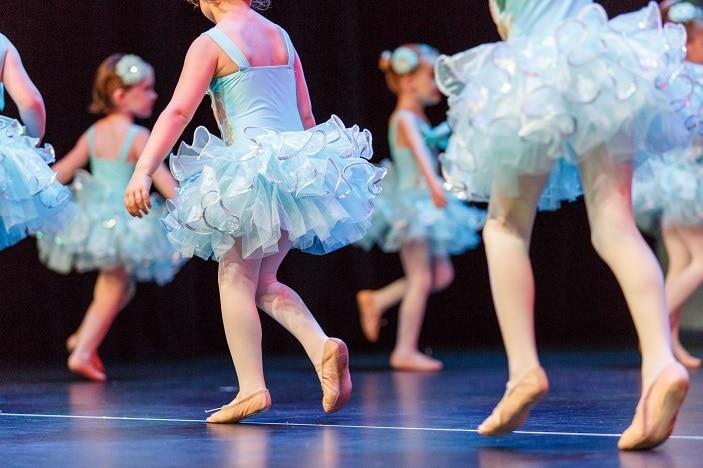 toddlers in blue tutus dancing ballet