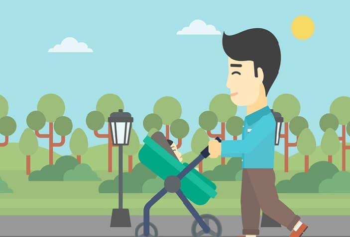 a dad walking with a pram