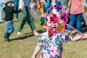 kids at festival, festival rides, laughing child, having fun