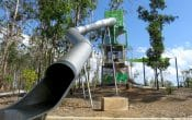Very long tube slide in an outdoor park