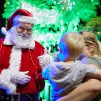 Santa and child at the carols