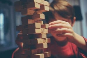 kids playing jenga