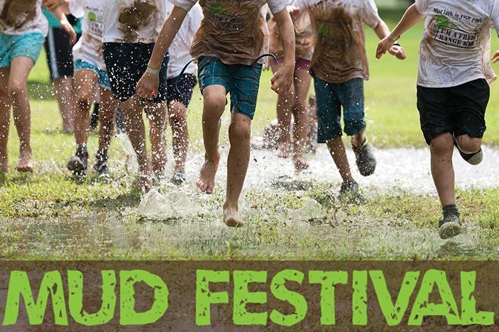 mud world festival, kids running in mud, muddy kids, splashing