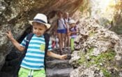 Little boy and his family hiking in Majorca mountains