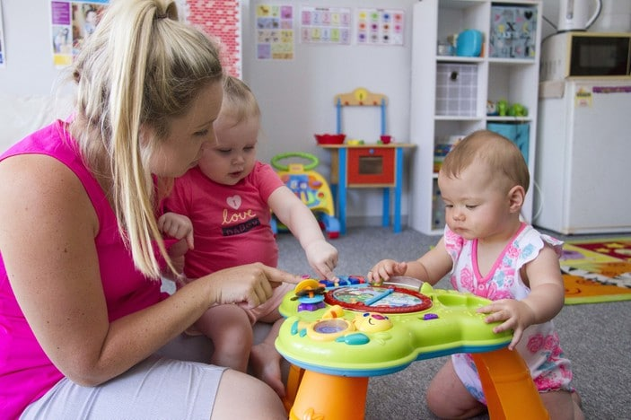 Churches of Christ Care, family day care, carer with toddlers