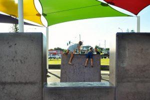 children climbing sttone wall