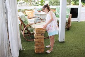 girl playing giant jenga