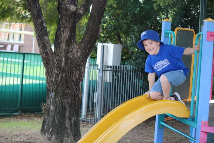 Cannon Hill Community Kindergarten , child on slide, kindy in Cannon Hill