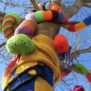 jazz and jumpers in july , tree jumpers, tree, winter, knitted snake in tree