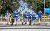 School children walking and taking bikes to school