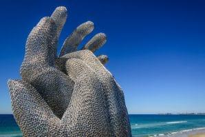 Swell art festival, beach, giant hands