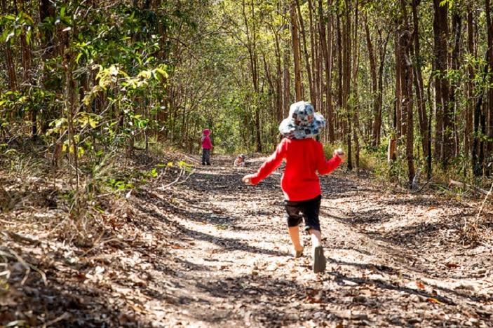 Child running through the bush