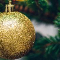 Carols at Multicap, tree and gold Christmas decoration