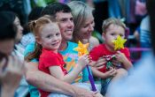 Christmas in Brisbane parade, family with star lights