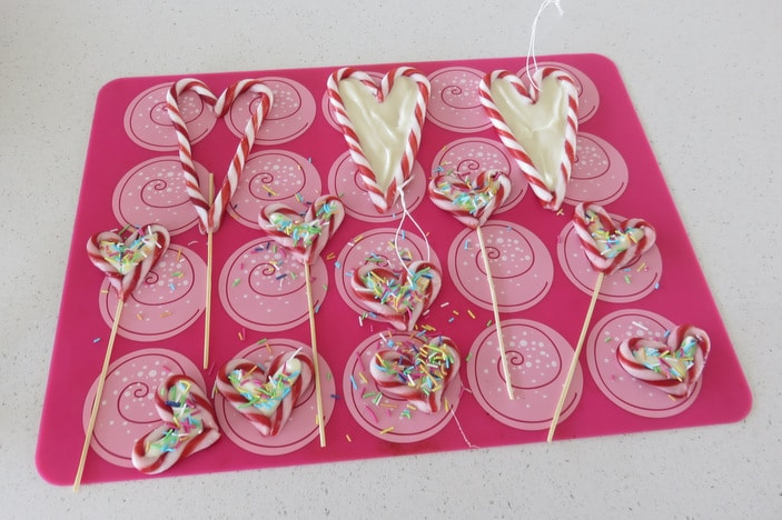 Candy cane hearts with white chocolate and sprinkles