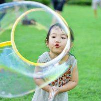 West village twilight kids blowing bubbles