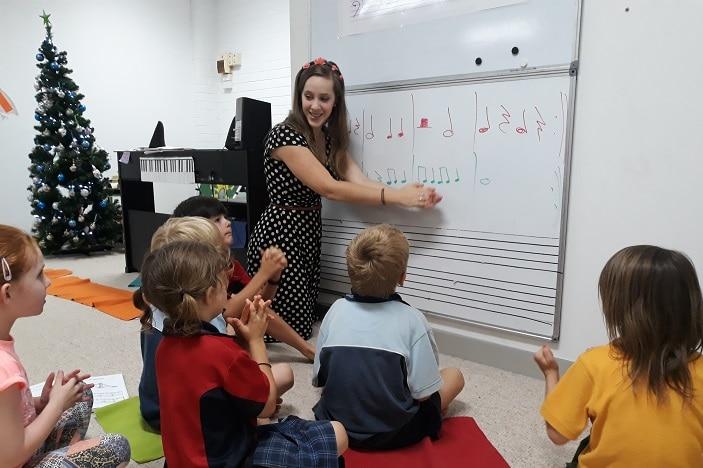 music lessons, kids, teacher whiteboard