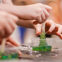 make your won slime workshops, green slime with glitter