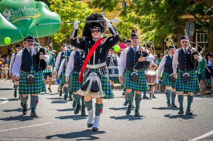 st patricks day parade, marching band, bagpipes, kilts, green